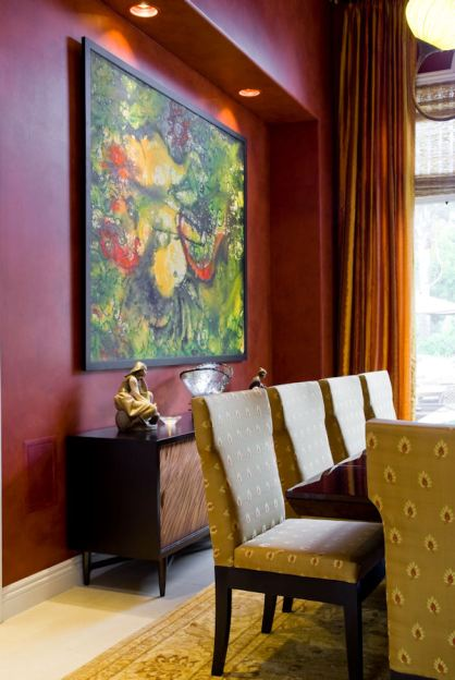 Original artwork fills the room with bright, bold, color.